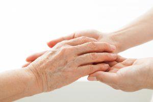 握りあう手